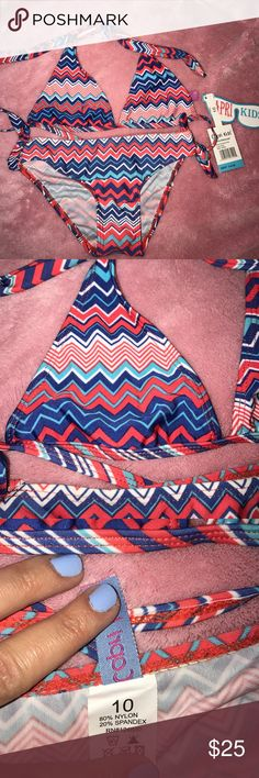 Capri kids multi color bikini size 10 Size 10 bikini NWT. Multi colored zig zag design.  Tie top. Bottoms have cute tie design on the sides. Swim Bikinis