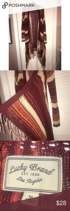 """Lucky brand cardigan Long lucky brand fringe cardigan! I'm 5'4"""" and the longest point goes to my calves. It's in perfect condition and only worn a few times! I had this posted before and thought I gave it away but found it hidden in my closet!! Super cute Lucky Brand Sweaters Cardigans"""