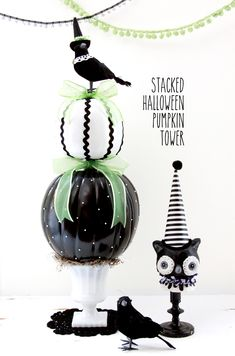 Black and White Halloween Pumpkin Tower - I especially like the crow with the witch's hat.