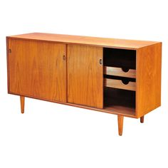 Early 1950's Teak Danish Credenza by J. Clausen for Brande Mobelfabrik | From a unique collection of antique and modern credenzas at http://www.1stdibs.com/furniture/storage-case-pieces/credenzas/