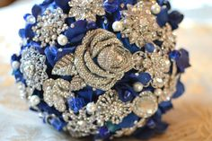 Sapphire rose jewelry bouquet by Noaki on Etsy...i love these!
