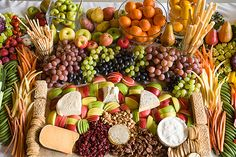 Beautiful  6 cheeses- humble fog goat cheese, blue- camembert or Roquefort, brie- d'affinois, le'eppoise, explorator, aged gouda, whiskey cheddar, assorted sliced apples, pears, candied pecans, dried fruits, flat bread, crackers, bread sticks, honeycomb.