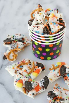 This easy Halloween Candy Bark recipe can be adjusted for any holiday or occasion! It's fun and easy to make and makes a perfect sweet and salty snack!