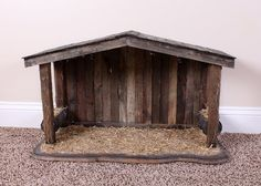 A natural wooden nativity stable. The stable is made of an aged, barn siding type wood. The stable has a pitched roof and hay feeding troughs to either side of the central space where a Nativity sc. Nativity Stable, Nativity Creche, Outdoor Nativity, Christmas Nativity, Christmas Wood, Christmas Crafts, Christmas Decorations, Christmas Printables, Christmas Bells