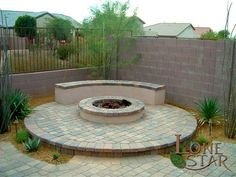 Fire pit and bench built onto a circular paver pad in Phoenix, Arizona. - www.lonestaraz.com
