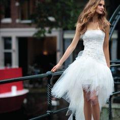 http://www.facebook.com/Theboutiquedresses    Cute short wedding dress!