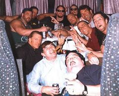 Paul Bearer partying with Shawn Michaels, Triple H, and The Undertaker: