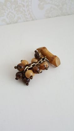 Finnish vintage brooch, made in the The brooch consists of a small branch piece and a berry bunch hanging from it. Light berries are made of wood and darker ones are plastic. Made Of Wood, Vintage Brooches, Berries, Stud Earrings, How To Make, Ear Studs, Bury, Earring Studs, Blackberry