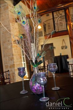 Some of our centerpieces... Peacocks and Purple