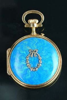 An enamel fob watch, circa 1900,  circular, the dial with Arabic and Roman numerals and diamond-set hands, the case decorated with blue guilloché enamel and a rose-cut diamond garland, suspended from a later bow brooch hanger, signed A. Golay-Leresche, Geneve