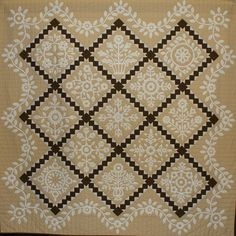 "Whitework Sampler, 79x79"", by Tommie Crocker.  Hand appliquéd, machine quilted by Cynthia Clark. Design by The Rabbit Factory (Ontario, Canada)"