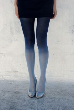 From M Trimming: Ombre Tights (re)fashion DIY tutorial. Pictured are a pair of light blue tights, dyed with navy blue dye. The result is a lovely gradient effect.