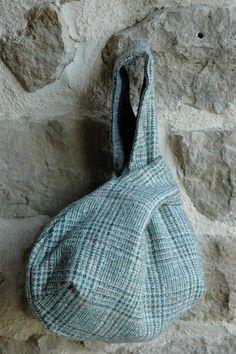 Reversible Japanese knot bag, clutch size, wrist strap.