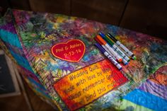 Ashley's mom is a quilter and handmade the colorful guest book with personalized embroidery. She also recruited her quilter friends to contribute blankets for guests at the chilly outdoor reception.