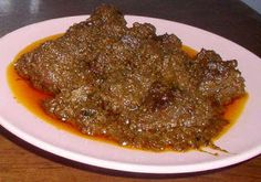 Rendang Padang: beef cooked with spicy seasoning and thick coconut meat. Originally from West Sumatra, Indonesia. Spicy Recipes, Asian Recipes, Cooking Recipes, Indonesian Cuisine, Singapore Food, Padang, Food To Make, Food And Drink, Favorite Recipes