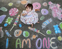 sidewalk chalk art baby photo shoot for Helena's first birthday