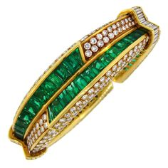 1990s Harry Winston Emerald Diamond Gold Bangle Bracelet From a unique collection of vintage bangles at https://www.1stdibs.com/jewelry/bracelets/bangles/