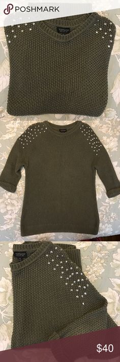 Topshop Studded Cable Sweater Topshop • Studded cable sweater • 3/4 sleeves with stitched in place cuffs • Studs on shoulders front/back • Army green knit • In excellent condition with minimal wear visible on elbows • Made in Turkey • 100% cotton • Size 4 Topshop Sweaters Crew & Scoop Necks