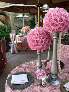 From Yvonne Designs. A lovely pink rosette linen! A little too much for an entire table? Use a pink rosette runner! Silver charger plates complete the look.