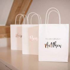 FREE DELIVERY ON EVERYTHING! Gifts for the Bridesmaids? Surprise for the Groom? Our personalised gift bags are a perfect way to give your loved ones that extra special something. Each white paper back can bepersonalises with a name and their role, for example, Bride, Groom, Best Man. Textcan be in a range ofdifferen Baby Shower Party Bags, Bridesmaid Gifts, Bridesmaids, Personalized Gift Bags, Rose Gold Foil, Goodie Bags, White Paper, Bride Groom, Paper Shopping Bag