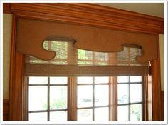 Outline a funky shape on a cornice with nail heads (this blog has good window treatments)