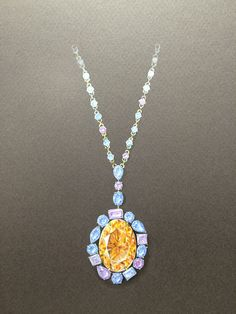 """A """"simple"""" pendant with orange and various blue sapphires. About 5 hours of work."""