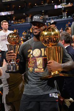 LeBron James of the Cleveland Cavaliers holds his MVP and Championship Trophy after the game against the Golden State Warriors during the 2016 NBA...