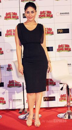 Kareena Kapoor looking smoking hot in a black Ports 1961 dress with Tom Ford sandals and a pony-tail. #Bollywood #Fashion #Style