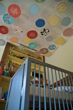 Embroidery hoops hanging from ceiling above crib - a giant mobile - clever idea!!!!