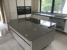 This is the Grigio Chiaro Pura. This is a light grey style quartz, that's soft and appealing. White Gloss Kitchen, Granite Colors, Window Sill, Building A House, Kitchen Island, Grey Style, Windows, Colours, Ponds