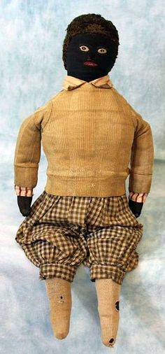 stuffed cloth boy doll, with individually stitched fingers, checkered trousers, and striped cotton shirt with antique sweater atop it, Georgia, United States, 1890, maker unknown.