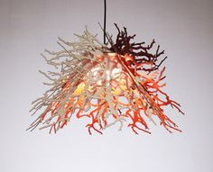 """$240.00    The Abstraction pendant light is made up of 8 laser-cut """"leaves"""" that, when put together form a beautifully contemporary sculptural light. All of the """"leaves"""" are interchangeable with the other colors and shapes in the series, allowing many different creative designs.    Includes 15' black cordset with plug and toggle switch. Max 40 watt bulb. Bulb not included.  Material: Renewable cotton mat.  Shade dimensions: 19"""" x 20"""" x 20"""""""