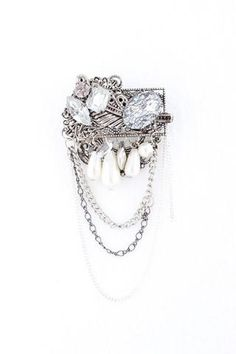 Salute To Silver Pin $50 - Hello there, soldier. Who says you can only play with earrings, rings, bracelets and necklaces? This beautiful vintage-look pin can easily be used on any top, outerwear or bottom.
