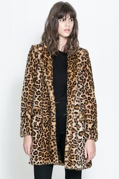 22 Faux Fur Coats For A Wildly Warm Winter #refinery29  http://www.refinery29.com/59635#slide20  Zara Leopard Furry Coat, $129.99, available at Zara.