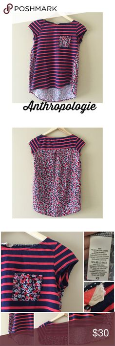 """Anthropologie Backstory floral/striped tee XS Anthropologie Backstory floral (red, navy, pink, lavender, & mint) and red/navy striped capped sleeve tee. One front pocket on chest, boatneck, and higher in front. 71% cotton, 29% polyester. Gently worn but good condition! 16"""" bust, 21"""" long in front, 25"""" long in back. Bundle & save Anthropologie Tops Tees - Short Sleeve"""