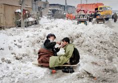 An Afghan street barber sits on a plank in the snow as he trims the mustache of a customer in Kabul, Feb. 9, 2012. The National Weather Center meteorologist Abdul Qadir Qadir said temperatures in Kabul dipped as low as -16 Celsius (3 Fahrenheit), with the lowest temperature previously on record at -17C (1F), recorded about 15 years ago. The coldest temperature on record for Kabul was -26C (-14.8 F) and was recorded 40 years ago, he said.