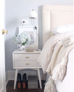 simple nightstand styling white and blue bedroom with tassel throw by Alaina Kaczmarski