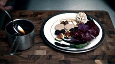 """Hannibal Season 1, Episode 5, """"Coquilles"""" Bella Crawford refuses to eat this dish of foie gras au torchon with a late harvest Vidal sauce and figs because it's cruel. Hannibal tells her not to worry, because he only uses an """"ethical butcher.""""  http://www.vulture.com/2014/03/see-every-food-porn-shot-from-nbc-hannibal.html#photo=8x00013"""