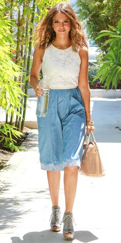 Jessica Alba embraced culottes (one of this season's hottest silhouettes), styling her chambray pair with an ivory floral tank, a nude perforated tote, and lace-up booties.