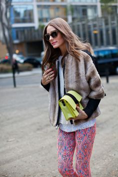 printed pants and neon bag