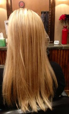 All over blonde highlights and lowlights with long layered razor cut