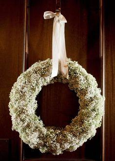 Pretty baby's breath wreath by Tami Winn Events. Photo by Kassie Moore Photography. #wedding #wreath #decor #white