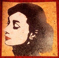 Tribute to Audrey Hepburn -   Audrey Hepburn - 1956 Portraitist Yousuf Karsh -  30x30cm -  Soggetto realizzato con stencil fatto a mano, colori acrilici spray su sughero. -  Subject made with handmade stencil with acrylic colours on cork. -  Per informazioni e prezzi: manualedelrisveglio@gmail.com