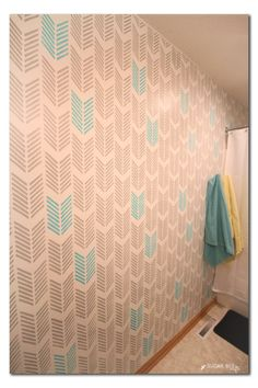 The Drifting Arrows wall stencil in a bathroom painted in gray and turquoise. http://www.cuttingedgestencils.com/drifting-arrows-stencil-pattern-diy-decor.html