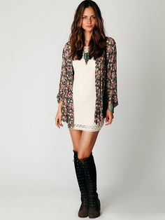 Love the outfit. Lace dress, lace up boots, and floral kimono jacket with artsy/boho jewelry.