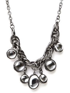 Mirror, mirror on the wall, which is the coolest bib of them all? You're looking at it. This statement necklace flaunts streetwise gunmetal links and a dazzling array of mirrored bauble pendants.