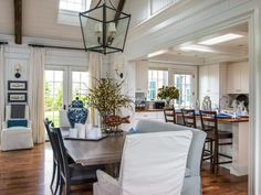 Illustrates how the kitchen could connect to the great room, the great room being open.the ceiling two levels high with exposed beams and a loft. The kitchen ceiling at one level.