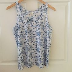 Fun silky summer tank This tank is so cute, fun patterns on it, perfect for jeans or shorts! Worn once, it's XS but fits like a small. Frenchi Tops Tank Tops