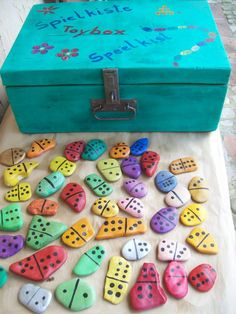 Painted rocks can be dominos! Fun summer activity! Could paint music notes for music dominoes?