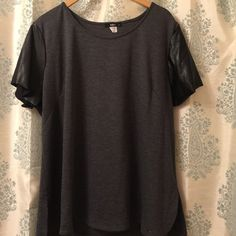 Charcoal tee with pleather sleeves. Charcoal tee with pleather sleeves. Zipper on back. Super cute. Worn once. ING+ Tops Tees - Short Sleeve